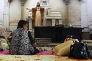 img-_antPrmPianoTpl1-_iraqi-christian-woman-fleeing-violence-iraqi-city-mosul-sits-inside-sacred-heart-jesus